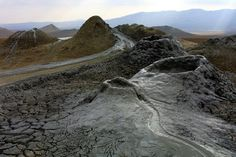 """Mud Volcanoes of Azerbaijan   9 Places You Never Want To Go On A Vacation :In 2001, a new island grew out of the Caspian Sea, due to an increase in volcanic activity—right nearby where hundreds of these bad boys are. Generally, they go off every twenty years, and when they do, they shoot flames """"hundreds of meters into the sky"""" and deposit tons of mud into the immediate area."""
