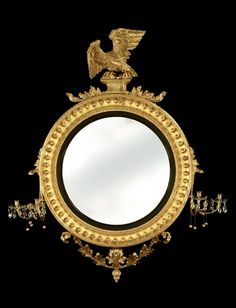 Huge Regency giltwood convex mirror with ebonised strip and fine carved eagle on a plinth, Continental Europe c. 1815