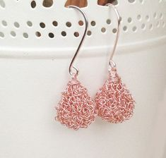 Thank you for visiting my shop. This pair of rose gold earrings has a simple design, adding a classy chic touch to any outfit. I Hand crochet the drop shaped components, and hung them on hand crafted ear wires. This accessory will upgrade your every look. -A perfect accessory for the modern