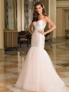 Look timeless in this Silk Dupion fit and flare silhouette with a sweetheart neckline with piping, dropped waistline, and tulle skirt with horsehair trim.