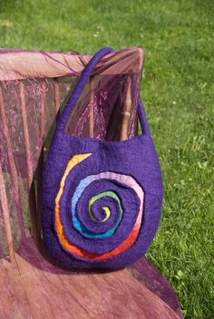 Purple handbag with a cut out rainbow spiral to make your head