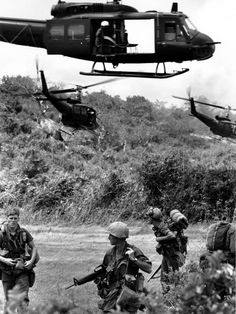 U.S. Army helicopters climb away from paratroopers of the U.S. 101st Brigade which they have dropped off in a clearing on a Mountainous jungle on March 7, 1966 northwest of Saigon during the Vietnam War.
