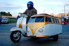 What an awesome vespa ~ love the VW bus sidecar.  Wouldn't a child love to go for a ride in that!