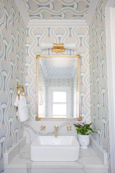 Powder room makeover Small spaces are the perfect place to make a splash! Charleston Shop Curator chose the Utopia Small Double Bath Sconce by Kelly Wearstler to brighten her patterned powder room. Steam Showers Bathroom, Small Bathroom, Bathroom Ideas, Minimal Bathroom, Bathroom Mirrors, Bathroom Cabinets, Master Bathroom Wallpaper Ideas, Bathroom Faucets, Bathroom Moulding