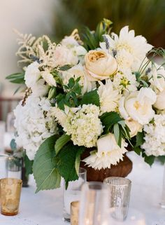 Ivory and Green Garden Centerpiece | photography by beauxartsphotogra... | floral design by sbchic.com/