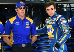 Chase Elliott Photos - Chase Elliott, driver of the #24 NAPA Auto Parts Chevrolet, talks to crew chief Alan Gustafson in the garage area during practice for the NASCAR Sprint Cup Series GEICO 500 at Talladega Superspeedway on April 29, 2016 in Talladega, Alabama. - Talladega Superspeedway - Day 1