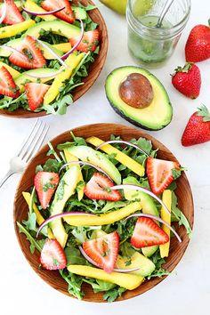 Mango, Strawberry, and Avocado Arugula Salad Recipe on twopeasandtheirpod.com.