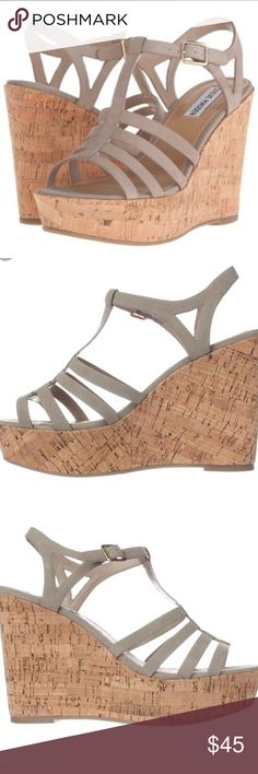 Steve Madden Wedges Size 10                                                                          Leather or nubuck upper. Ankle strap with buckle closure. Open-toe silhouette. Man-made lining. Lightly padded footbed. Cork-wrapped platform wedge. Man-made sole. Imported. Product measurements were taken using size 9, width M. Please note that measurements may vary by size. Measurements: Heel Height: 4 1⁄2 in Platform Height: 1 1⁄2 in                                                    NWOB…
