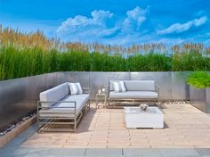 For this landscape project, the Borealis slabs were used in this small backyard to create a warm outdoor seating area with water features on this urban rooftop. These splinter-free concrete slabs are perfect if you want a wood look for your deck or your patio, but without the maintenance.
