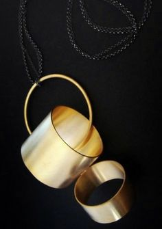 Contemporary geometric and architectural metal art jewelry by Erato Kouloubi in Greece - pendant Goldplated bronze, oxidized silver 2012