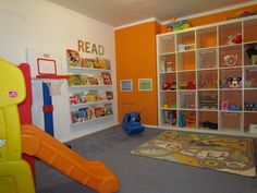playroom idea! Like the book area and huge storage shelving