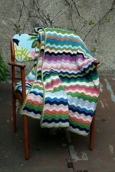 I will eventually learn how to knit that. Cute chair too!