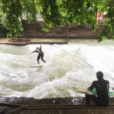 Popular Munich us gnarliest surfers hit Eisbach at Englischer Garten park