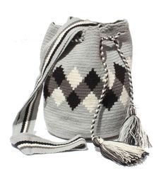 This unique piece of art is handmade by Wayuu aboriginals in the North Coast of Colombia. The Mochila bag is the greatest expression of the Wayuu tribe weaving art; its vivid colors and geometric shapes symbolize the spirituality and mythology of this ethnic group. Each bag is intricately and tightly woven under croc