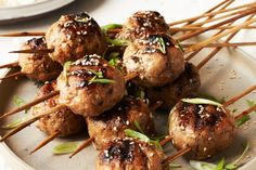 These skewered meatballs are a quintessential Japanese bar food¿a great drinking snack that can be turned into a larger meal with rice. Flavored with plenty of garlic and ginger and brushed with a sweet-and-savory soy glaze, these meatballs are a great de Meatball Recipes, Turkey Recipes, Antipasto, Japanese Chicken, Japanese Bar, Food On Sticks, Ground Chicken Recipes, Skewer Recipes, Asian Recipes
