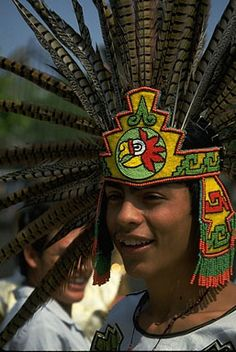 young woman wears aztec head dress festival guadalajara mexico central america south no model release