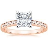 This classic engagement ring features cathedral archways adorned with dazzling French pavé diamond accents and a lofted prong-set center gem (0.10 total carat weight).