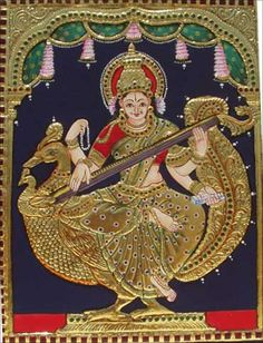A smiling Goddess Saraswathi depicted in golden hues in traditional South Indian Tanjore painting