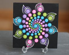 Hand-painted Mandala on a canvas. Painted with high-quality acrylic paints, . Hand-painted Mandala on a canvas. Painted with high-quality acrylic paints, with a gloss finish for protection. Dot Art Painting, Rock Painting Designs, Mandala Painting, Pebble Painting, Painting Patterns, Pebble Art, Stone Painting, Mandala Painted Rocks, Mandala Rocks