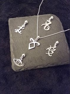 Interchangeable Set of 5 Silver Plated Rune Charms on a inch or 18 inch silver plated snake chain necklace. Friendship Charm: Size: 22 x Love Charm: Size: 23 x Clairvoyant Charm: Size: 20 x Angelic Rune Charm: Size: 20 x Healing Rune Charm: Size: Shadowhunters Tv Show, Shadowhunters The Mortal Instruments, Cassandra Clare Books, Love Charms, Organza Gift Bags, Runes, Necklace Set, Geek Stuff, Bling