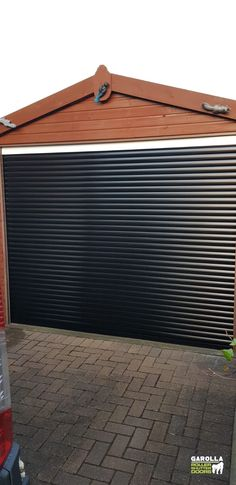 Whether you opt for Black Sectional Garage Doors or a Black Roller Garage Door, Black Garage Doors are effortlessly stylish. Click the link to see our roller shutter doors for sale. Black Garage Doors, Garage Door Paint, Garage Door Decor, Garage Door Makeover, Garage Door Design, Black Doors, Roller Doors, Roller Shutters, Contemporary Garage Doors