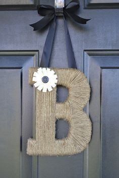 Twine & foam board monogram for the front door. Inexpensive and so easy!