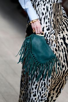 wgsn:  Gorgeous fringed handbags and luxe abstract animal prints kept the tribal feel alive at @Maison Valentino #PFW