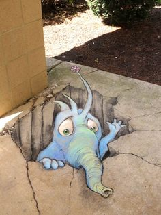"""David Zinn: Another basic hole creature that's been in hiding since the classroom workshops of September: """"The Garlanded Molephunt (with minimal garlanding)."""" — in Wabash, Indiana - 11/3/2014"""