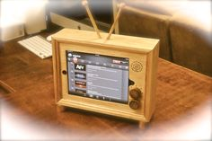"The ""iPad TV""  retro wooden docking stand for iPad 1, 2, and 3. $99.00, via Etsy."