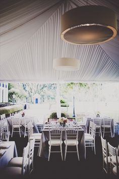 Square tables and draped tent. Love it all