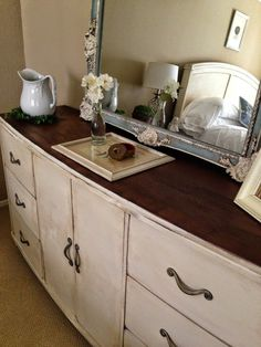 Dresser painted in Old White Chalk Paint by Annie Sloan by Bliss and Blossom Designs, top refinished in dark walnut.