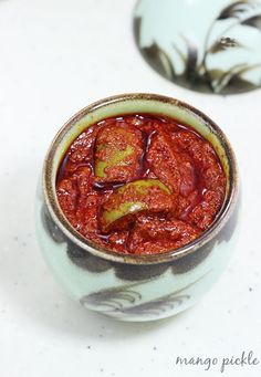 mango pickle recipe with step by step photos. Spicy, hot and tangy pickle made using raw unripe mango in a South Indian Style.