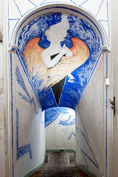 Jean Cocteau embellished stairwell at the Villa Santo Sospir.  via www.improvisedlife.com
