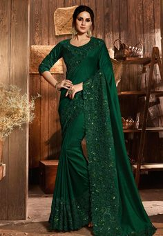 Dark Green Pure Silk and Net Saree. The saree is beautifully weaved together with resham embroidery, patch work with stone work, sequins work and cifli work. The saree comes with a dark green dupion silk blouse with matching work and cotton lining. Fancy Sarees, Party Wear Sarees, Sari Dress, Sari Blouse, Party Kleidung, Indian Designer Sarees, Embroidery Saree, Embroidery Motifs, Net Saree