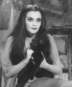 Birthday girl Yvonne De Carlo (September 1, 1922 – January 8, 2007), as Lily Munster, holding the Munster family's pet cat, Kitty, who roared like a lion.