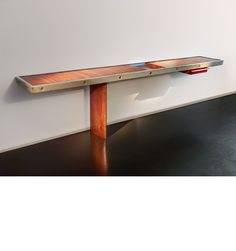 Charlotte Perriand (1903-1999)  Maison de la Tunisie console  Wooden rectangular top, metal strapping, resting on a single tapered leg 73 x 279 x 42.5 x cm