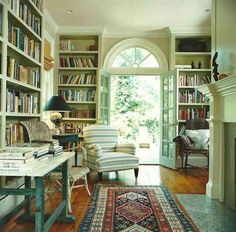 love the light green color onn walls/library shelf & ceiling. Notice the table & lamp next to the chairs. personal libraries…