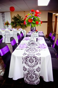 Event: Black & White Spandex Chair Covers, Purple Satin Sashes, White & Black Polyester Tablecloths, Damask Table Runners, Purple Mirrored Vases, & Lavender Napkins
