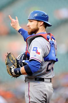 Jonathan Lucroy #25 of the Texas Rangers motions that there are two outs in the second inning against the Baltimore Orioles at Oriole Park at Camden Yards on August 2, 2016 in Baltimore, Maryland. (Photo by Greg Fiume/Getty Images)