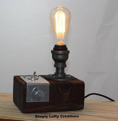 The Alex Overview -The Edison bulbs provide an inviting light that warms any room. -Hand crafted. Made in USA. -Bulbs have 3000 burn hours (roughly 5 years of use) -40 Watt Edison bulbs produce a warm yellow light - 2700K temperature light -Toggle switch incorporated into the