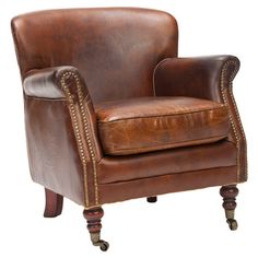 Enjoy an after-dinner cigar or glass of brandy in this classic leather arm chair, a handsome addition to the library or study.  Prod...