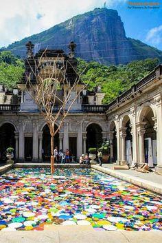 Floating Artwork and Rio's Famous Figure at the Modern Art Exhibit near the Tijuca Rainforest National Park in Rio de Janeiro, Brazil | Traveldudes Social Travel Blog & Community: