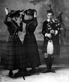 Old photograph of traditional dancers and young Scots Piper in Highland Perthshire, Scotland.