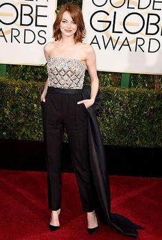 EMMA STONE La estrella se destacó en esta alfombra con este enterizo de Lanvin, tacones de Christian Louboutin y aretes de Lorraine Schwartz.