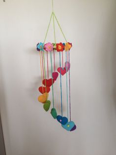 ** Only 1 in stock ** A super cute hearts and flowers mobile. The mobile is very nice to hang from the ceiling in a girls room, this will be equal to be cheered up.  I have the mobile itself. For the hearts and flowers are different colors Catania 100% cotton. The ring is of wood and very sound. Unlike on the picture has the mobile I have a pink in stock suspension thread at the top instead of the green. Furthermore, the mobile identical.