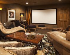Top 10 Best Home Theater Design Ideas for 2019 - Home and Gardens Home Theater Seating, Room, African Room, Home Theater Design, African Themed Living Room, Home, African Home Decor, Apartment Decor, African Living Rooms