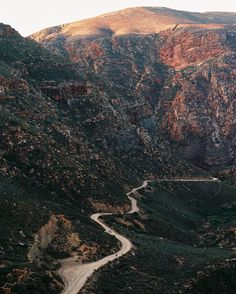Heading up the intense Swartberg Pass climb at sunset. Our idea was to reach the top by nightfall and camp wild near the Hell turnoff. #karoobaix #35mm by stanengelbrecht