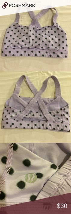 Lululemon sport Bra size 6 Lululemon sport Bra size 6.  Pretty lavender with black polka dot sports bra.  No padding underwire or bones.  Excellent condition. lululemon athletica Tops