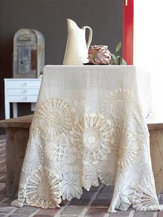 Grandma's old doiles with new linen table cloth. Stitch Doilies onto Table cloth, embellish with buttons, ribbon, embroidery - inspired! Found LOTS of doilies and can't bring myself to toss them. Sewing Crafts, Sewing Projects, Diy Projects, Diy Crafts, Red Brolly, Wedding Tablecloths, Lace Tablecloths, Lace Doilies, Crochet Doilies