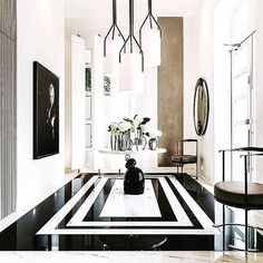 Graphic and luxurious black and white foyer